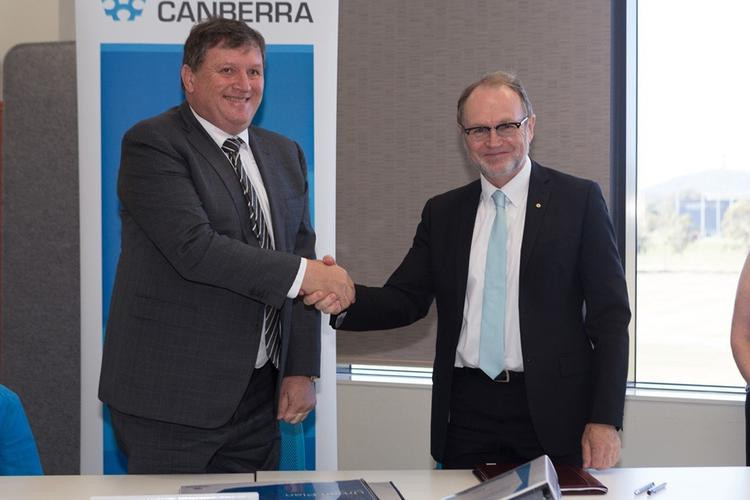 Vice-Chancellor Professor Stephen Parker and Moran Health managing director Peter Moran sign an agreement to build an aged care facility on campus.