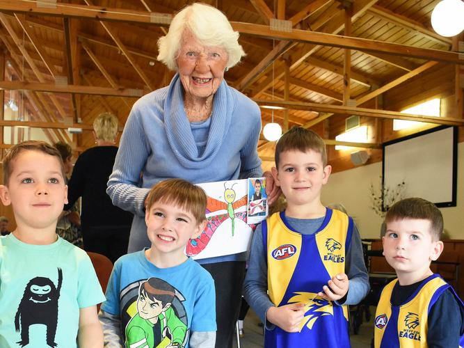 Jean Linehan, aged 103 years with Montessori Kindergarten children [Source: Resthaven]