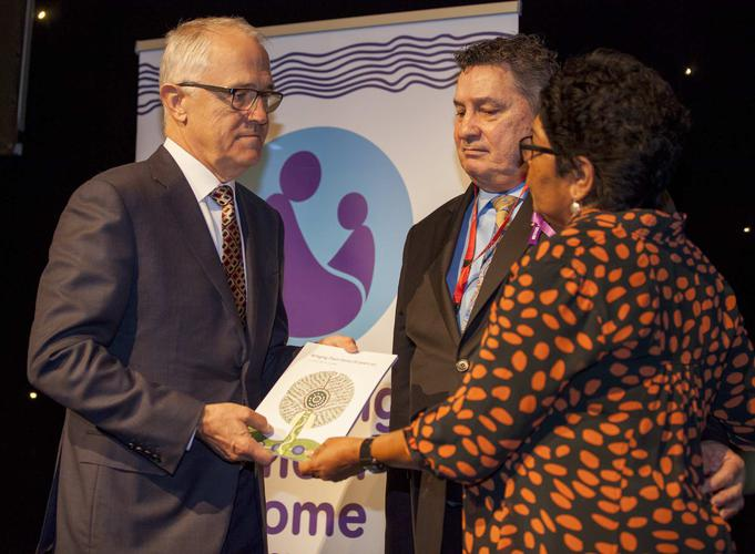 The Healing Foundation's Stolen Generations Reference Committee Chair Florence Onus and Board Chair Steve Larkin present the report to Prime Minister Malcolm Turnbull (Source: The Healing Foundation)