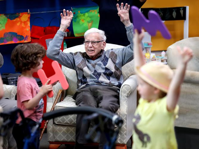 Old People's Home for 4 Year Olds star, 92 year old Stuart, a former a pilot in WWII, playing with the excitable Jax and Michaela. [Source: ABC]